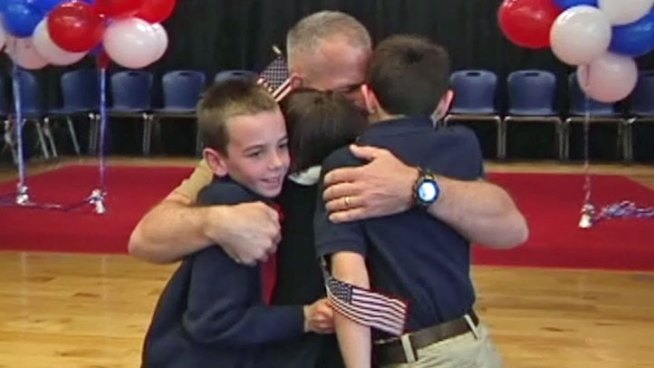 Marine Lt. Col. Patrick Johnson's homecoming was a special surprise for his three children during a school assembly at Dallas Academy Friday.