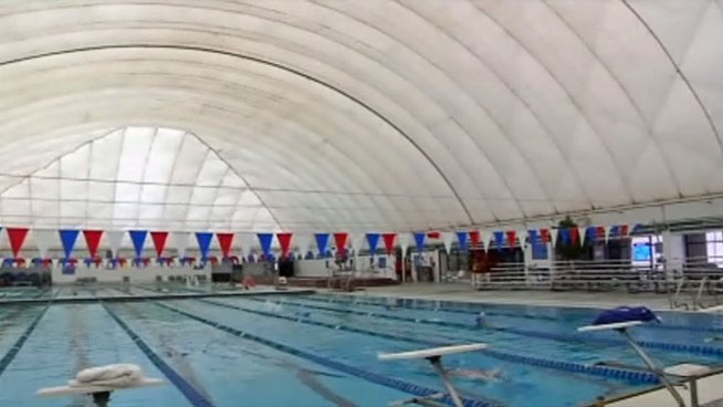For the first time the indoor/outdoor pool at the North Lake Aquatic Center in Irving is keeping its roof on during the summer months. It's a move that's saving the facility a lot of money.