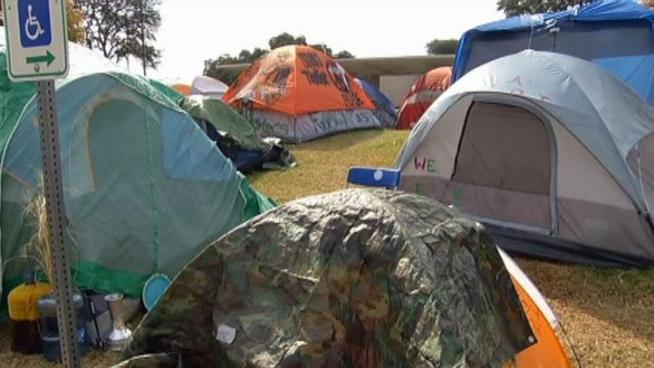 A federal judge says the city can evict Occupy Dallas' campsite, but the mayor says Dallas will not take any action until after both sides meet Wednesday.
