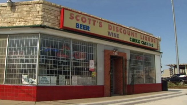 The owner of Scott's Liquors on South Lamar Streets says he's in a dispute with Dallas City Hall over parking at his business.