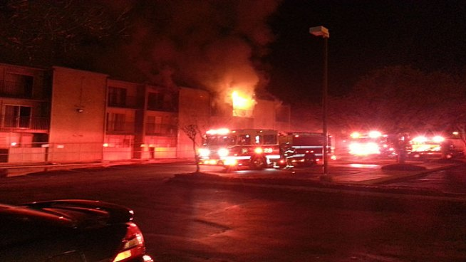 Firefighters worked to extinguish a two-alarm fire at a North Dallas apartment complex Friday morning, the same location as a fire only months ago.