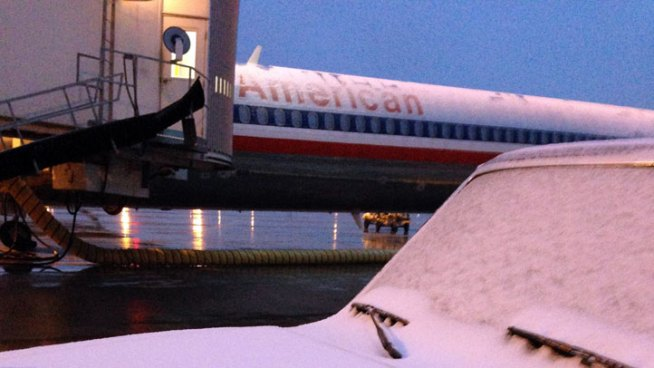 Hundreds of Flights Canceled Amid Ice, Snow