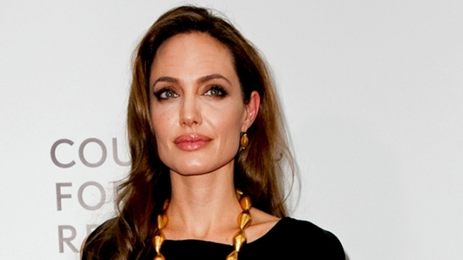 Angelina Jolie and Brad Pitt hit the red carpet for the premiere of Angelina's feature film directorial debut,