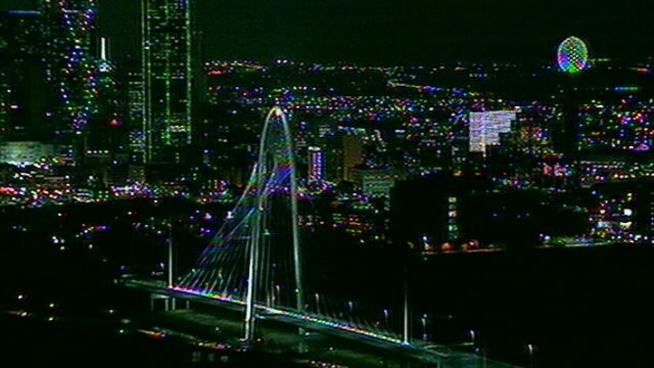 It took awhile but the lights on the Margaret Hunt Hill signature bridge in Dallas came on Tuesday evening.