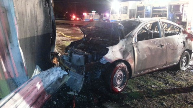 A burning car was driven into a Fort Worth game room Friday morning, setting the building on fire.