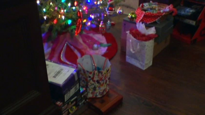 A burglar unwrapped the presents under a Dallas home's Christmas tree before stealing them.