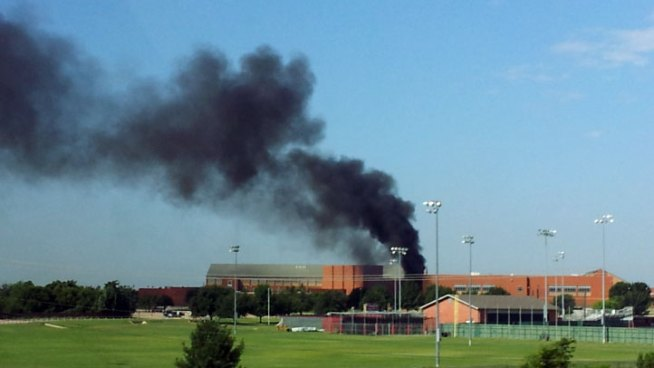 Tar Machine Starts Fire Near High School