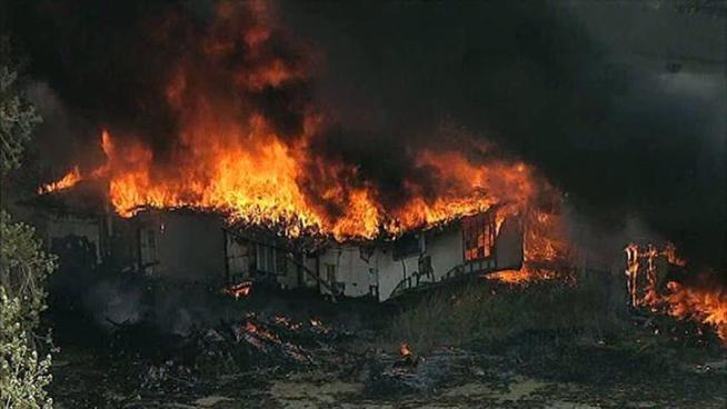 A fast-moving brushfire southeast of Dallas destroyed several homes.