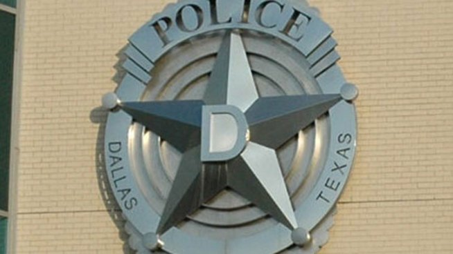 Dallas Chief Fires Two Officers