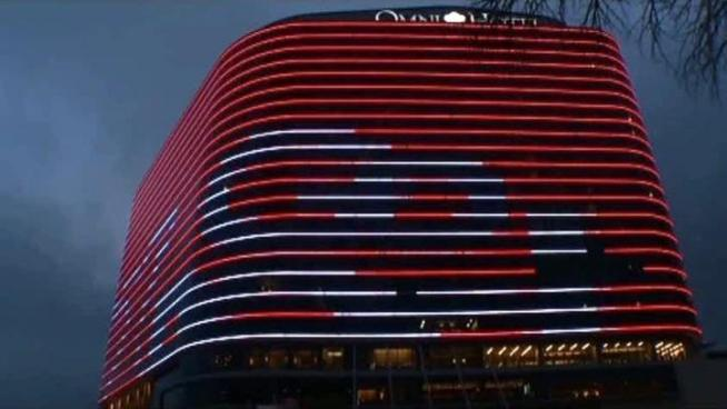 The Omni Dallas Hotel's LED lights have been displaying various company logos in an effort to to attract and retain convention business.