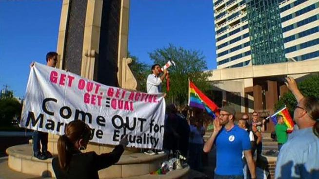 Dozens of gay rights supporters applauded President Barack Obama's statement on gay marriage, but a Dallas pastor said he doesn't agree with the president's position. Obama said in an interview Wednesday that he believes same-sex couples should be able to get married.