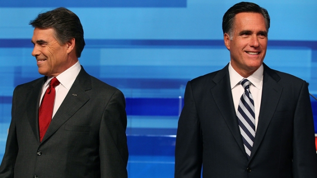 Perry, Romney Exchange Attack Ads