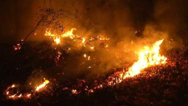 At least 12 structures were destroyed Thursday after a wildfire broke out near Lake Whitney.