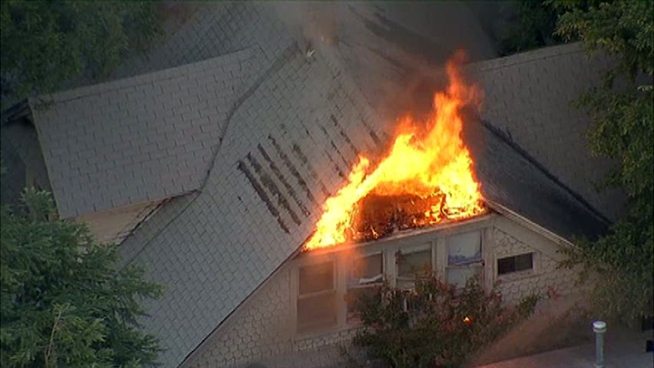 Dallas firefighters battled a house fire Tuesday night. No one was injured in the fire.