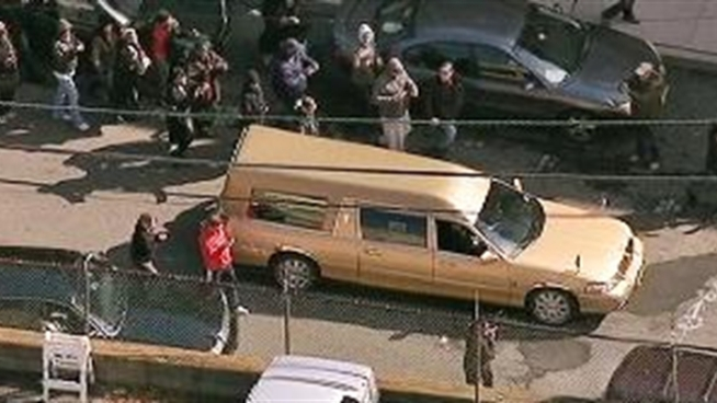 The hearse carrying the body of Whitney Houston leaves the Whigham Funeral Home in Newark, headed to Fairview Cemetery in Westfield, N.J.