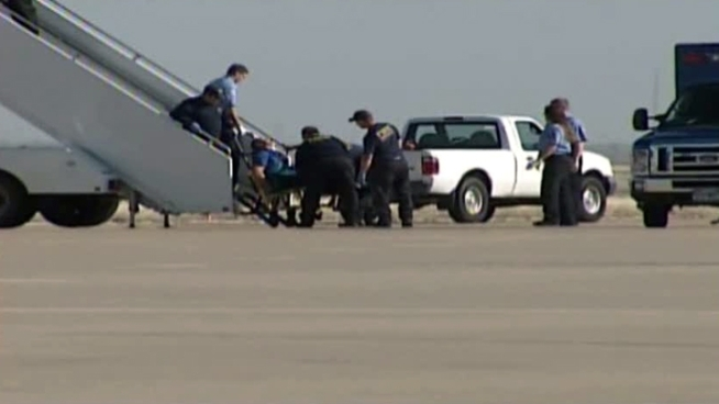 Several passengers restrained a Jet Blue pilot who apparently lost control of himself during a flight from New York to Las Vegas. The pilot is getting medical care in Amarillo, where the plane touched down after the co-pilot declared an in-flight emergency.