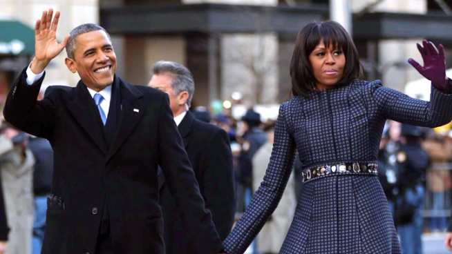 President Barack Obama and first lady Michelle Obama walk down Pennsylvania Avenue during the 57th Presidential Inauguration parade.