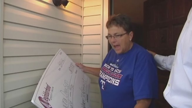 On Tuesday, Laura Dawson was surprised with a giant check, her reward for having a savings account and being diligent with her finances.