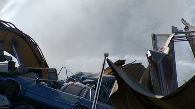 Cars at a Greenville recycling facility caught fire Thursday.