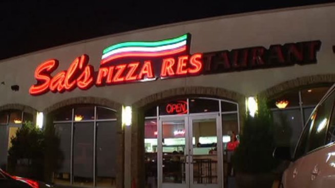 Fire forced a popular Dallas pizza place to close before the new year, but with hard work and community support Sal's is open again.
