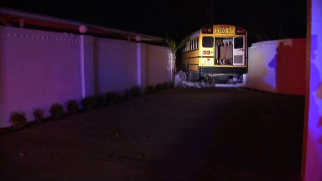 Police say a Fort Worth school bus crashed into a home after another vehicle pulled in front of the bus.