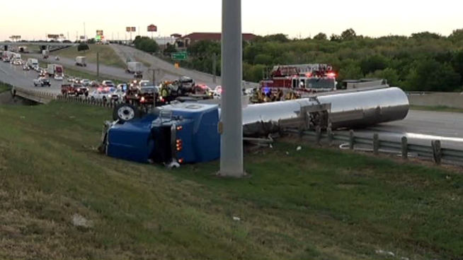 A semitrailer with a flammable liquid flipped over in a wreck on Interstate 20 in Dallas.