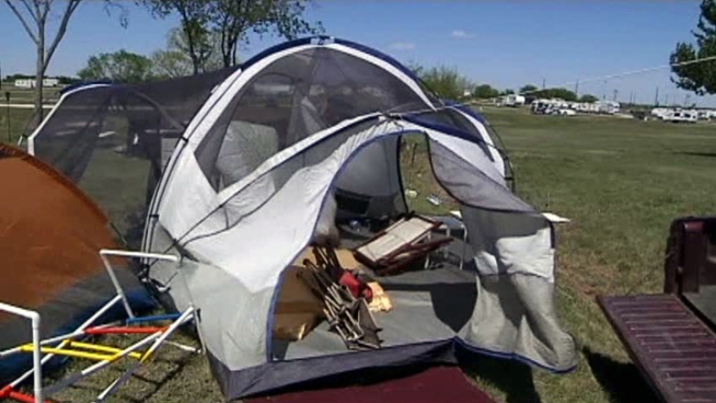 High-winds caught a few tents, but the high spirits of some early campers at Texas Motor Speedway couldn't be blown away by the gusty weather.