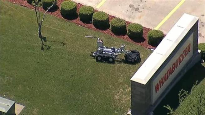 A suspicious package in front of a Whataburger is detonated by Plano police.