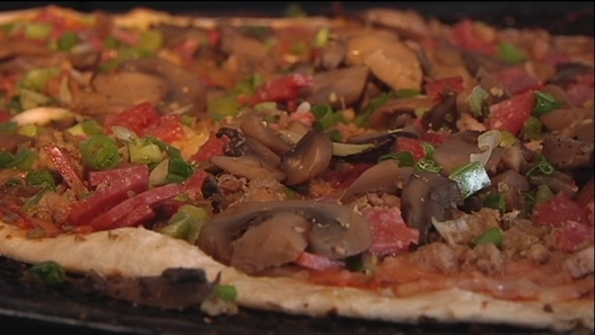 Fourth-generation owner David Campisi says his family's famous pizza was introduced by accident.