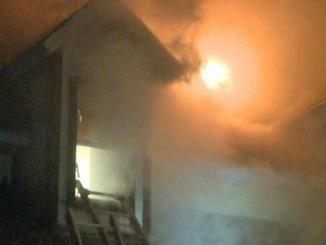 The Quinlan Fire Department had a tough time battling a house fire in the 11400 block of Highway 34 Tuesday night. Ammunition inside the home exploded for about 30 minutes.
