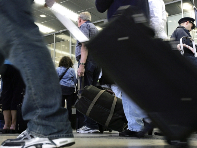 Fee-Weary Air Travelers Get a Break -- For Now