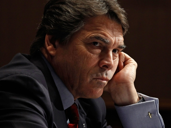 Perry Dishes on Fed in New Book