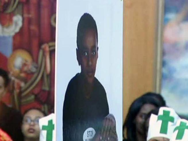 More than 1,000 people filled a Garland church Monday to say goodbye to a boy killed by a falling tree.