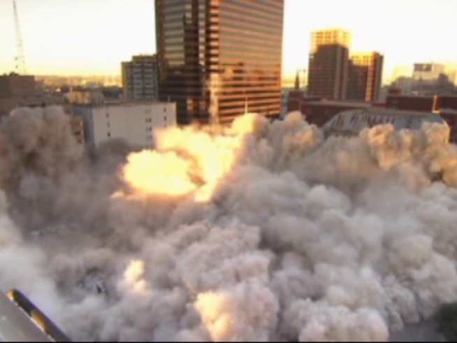 Spectators head downtown to watch the implosion of First Baptist <a title=