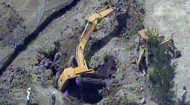 Excavator Falls Into Hole at Construction Site