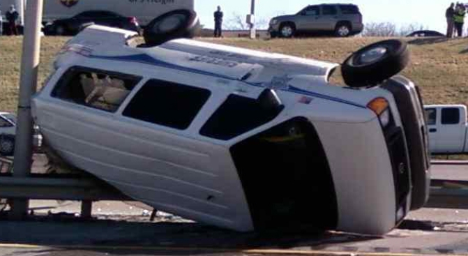 Prisoner Van Rolls Over on Loop 820